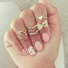 Midi rings and pink flower nails. So in love with these!