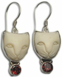 Garnet Cat Face Earrings Sterling Silver 925 Jewelry With Soul. $29.00. The money from selling this pendant will provide a livelihood for traditional village artisans in Bali.. Carved from Buffalo Bone in the tradition of centuries from the village of Tampaksiring, Bali. This beautiful piece of limited production jewelry comes at a very reasonable price.. Made from Solid Sterling Silver 925 using old style silver craftsmanship.. Handmade by the skilled silversmiths of Ubud, Bali