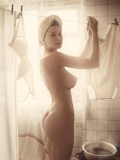 Nude woman hanging underwear (photo David Dubnitskyi)