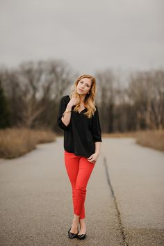 black flowy blouse and red pants