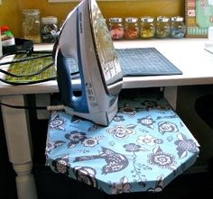 Hiding your ironing board has never been easier! Watch this video and learn how to make a slide-out ironing board that you can stow under your sewing table or desk.