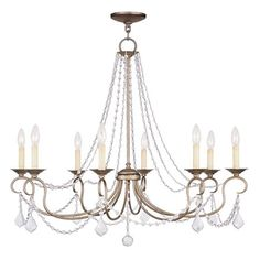Cast a warm glow in your dining room or master suite with this candelabra-inspired chandelier, showcasing draped beading and an antiqued silver leaf finish.