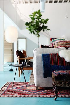 Turquoise floor with amazing rugs