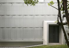 Hut House by Pencil Office, Singapore. Folded aluminium veil textured across the horizontal surface