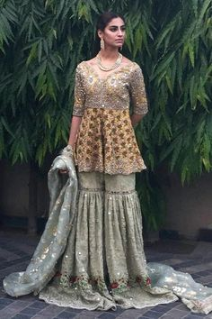 Latest Pakistani Short Frocks Peplum Tops Styles & Designs Collection consists of trends & styling of short frocks with bell bottoms, shararas, etc Pakistani Wedding Outfits, Bridal Outfits, Pakistani Dresses, Indian Dresses, Indian Outfits, Pakistani Garara, Fashion Designer, Indian Designer Wear, Designer Dresses