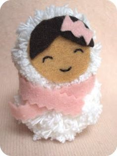 This little snow girl ornament is totally adorable and looks easy to make with pom poms!