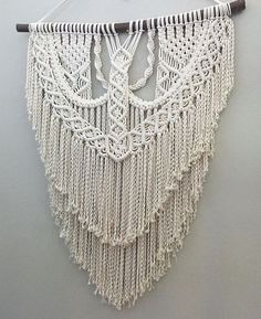 Extra large handmade macrame wall hanging using almost a thousand feet of 100% cotton rope carefully knotted around a wooden dowl and ready for hanging! It has lots of beautiful detail, layers, and texture. This piece is made to order and shipped out as soon as its finished. Please allow