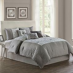 Create a relaxing bedroom with the elegant Lori Velvet Comforter Set. This sophisticated set pairs cool grey and warm ivory with beautifully embroidered vines, cut velvet accents, and a mix of textures for a soothing, serene ambiance you'll love.