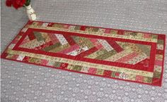 This beautiful table runner is worked in French Braid patchwork and is ideal for using Jelly Roll strips.
