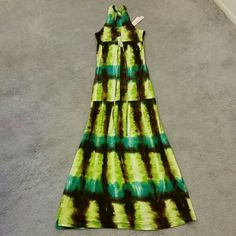 "Summer/Festival/Hippy/Beach Tie-dye maxi dress Razor back maxi dress. Made by Romeo and Juliet. Form fitting top part, and flowy drop waist.  Colors are mainly green, blue, and brown.  Length from top/shoulder to bottom/hem is approx 57"".  Size small, and has a nice stretch.  100% Rayon (very light fabric).  Made in the USA.  *Sorry, I can't model. Found this in the back of my closet, and it's just not my size anymore :) Romeo & Juliet Couture Dresses Maxi"