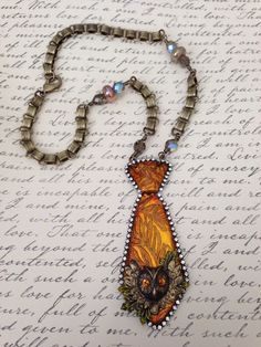 "March 2014 Challenge. ""What A Hoot"" etched and alcohol inked Tie Necklace. Made with B'Sue tie, owl and leaf stampings, rhinestone chain, book chain and Czech and glass beads."