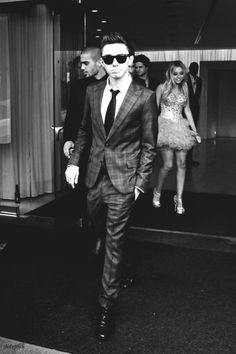 Nathan Sykes and he's other band mate Max George in the background