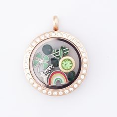 Rose Gold Floating Locket with green floating charms for March. Rainbow floating charm, dollar floating charm, 4 leaf clover floating charm. All on sale 15% off through Feb 2014. www.smashingfancy.com