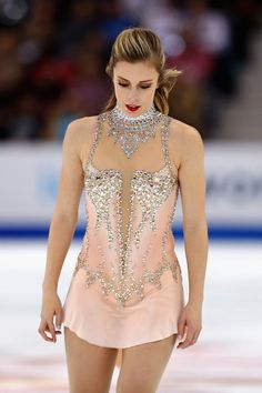 Ashley Wagner of the United States reacts as she withdraws from the Ladies' Free Skate due to medical reasons during day three of 2017 Bridgestone Skate America at Herb Brooks Arena on November 26, 2017 in Lake Placid, New York.