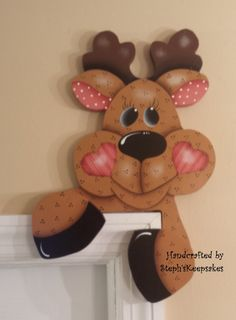 Hey, I found this really awesome Etsy listing at https://www.etsy.com/listing/152360585/hand-painted-wooden-reindeer-door-hanger