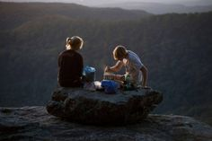 Top 10 Long Distance Hiking Trails in the US. A couple cooking a camping dinner, Ozark Highlands Trail. Arkansas
