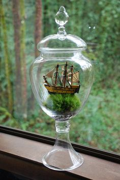 Terrarium with miniature ship on top of moss. Vintage jar. Sails, masts. weegreenspot on Etsy.