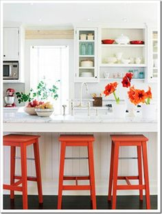 Lovely beach cottage kitchen with all the things you come to expect in kitchen like granite counters, stainless steel. I  Love the pops of orange. So invigorating and yet comforting. Just warms up the space.