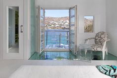 The 3 level 150 sqm Kivotos Mykonos Hotel Noah's Luxury Villa With Private Pool & Beach can host up to 7 people. It includes private pool, beach & more. Boutique Hotel Mykonos, Mykonos Hotels, Villa With Private Pool, Cerulean, Luxury Villa, Luxury Travel, Around The Worlds, Windows, Building