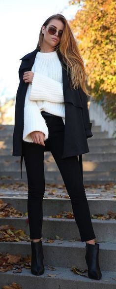 #winter #fashion / Oversized white sweater + black coat, skinny jeans & booties