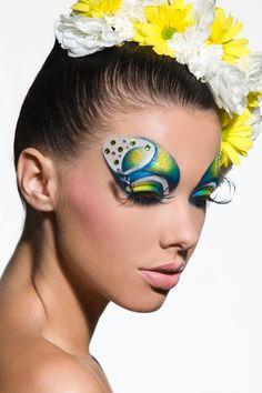 Bold yellow green blue butterfly eye makeup nude lips