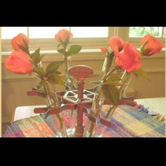 Old rubber stamp holder to display cut flowers.