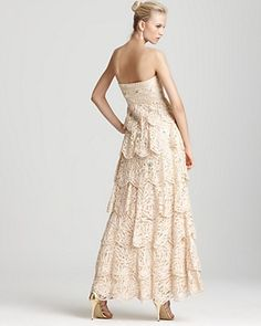 Sue Wong Gown - Lace Ruffle  PRICE: $568.00  Sue Wong Gown - Lace Ruffle  Nylon; lining: polyester  Spot clean  Imported  Strapless, bead and sequin embellishment  Tiered skirt, concealed side zip  Please refer to our Contemporary size chart  Web ID: 596714