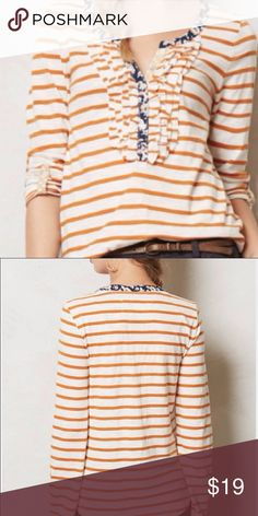 Anthropologie Postmark striped ruffle top medium Anthropologie Postmark white and orange/rust striped. Has ruffle detail and floral fabric detail on collar and side.   Size medium Anthropologie Tops