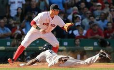 New York Yankees' Jose Pirela beats the throw to Boston Red Sox third baseman Garin Cecchini for a triple during the seventh inning of a baseball game at Fenway Park in Boston, Saturday, Sept. 27, 2014. (AP Photo/Charles Krupa)