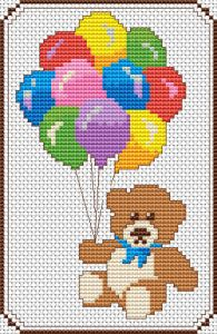 Cross stitch pattern of a baby teddy bear holding balloons.