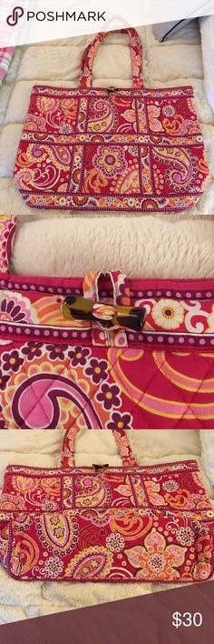 Large Pink Vera Bradley Tote Bright Vera Tote with lots of room for a work laptop or school books!  Used but in good shape, some discoloration on the bottom and handles, inside is nice and clean! Great for spring/summer!! Vera Bradley Bags Totes
