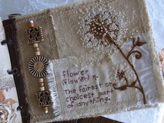 embroidered text  and the most beautiful embroidered flower  I have ever seen.