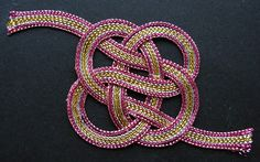A Mizuhiki knot, made from strands of cotton.