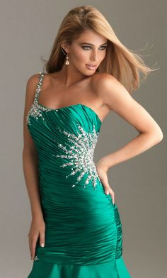 Emerald green one shoulder mermaid fit with a modified sweetheart neckline
