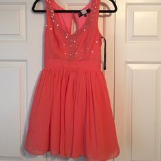 ASOS coral party dress Worn once. Asos dress. Peep hole back. Sequin front. Tulle poof. Little Mistress Dresses Prom