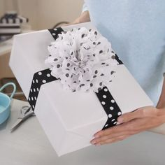 Learn how to make flowers out of tissue paper with this fun video from Hallmark. Tissue paper flowers are great for dressing up a gift or DIY party decor.