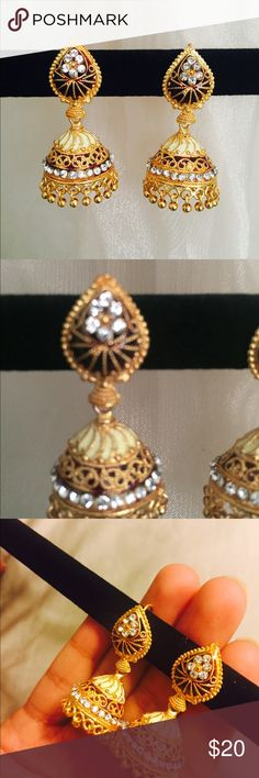 Jhumka earrings, gold, vintage Bollywood Earrings. These are beautiful earrings! They are gold with maroon and white accents. They are not too heavy and will not hurt your ears at all. Please let me know if you have any questions 😁 Jewelry Earrings