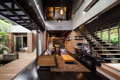 Gorgeous industrial living room of one of the Two Houses in Bangkok Thailand Industrial and Modern Side by Side: Two Houses in Bangkok