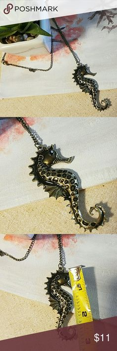 Bold bronze seahorse necklace Unique bold bronze seahorse necklace. Statement worthy and seahorse is approx 3inches in size, necklace length approx 26inches. New Jewelry Necklaces