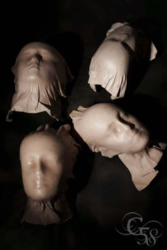 'the mortuary' moulded leather heads by Paul Seville