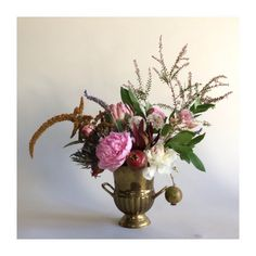 A brass bucket holds large  sweet smelling blossoms surrounded by branches and wild sprigs.  Built with the Dutch master's in mind, these arrangements are always unique and carefully composed.  This arrangement is built to be viewed from all sides, so would work well as a centerpiece.