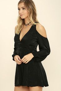 Let the Body and Soul Black Long Sleeve Romper lift your spirits! Woven satin fabric forms cool, cold-shoulders atop billowing, long sleeves (with button cuffs). Plunging V-neckline falls into a seamed bodice and relaxed shorts. Back cutout with two button closure. Hidden back zipper/clasp.