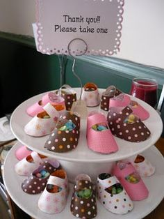 Baby shower ideas... baby shoes filled with treats for guest favors.