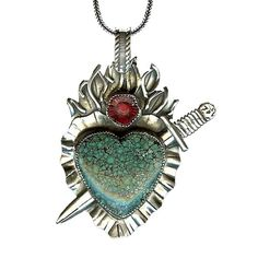 milagro necklace | Features a large turquoise stone.