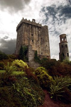 Blarney Castle, Ireland. This was just magical! First, I did climb to the top, lean over and down BACKWARDS over a 'murder hole' so I could kiss the Blarney Stone (I have a photo of that!). It's said kissing the stone gives you the Gift of Gab. Surrounding the castle is a large park with witch's caves, fairy circles, etc.