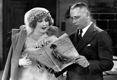 """Director Erich von Stroheim going through the piano score of """"The Merry Widow"""" (1925) with his star Mae Murray."""