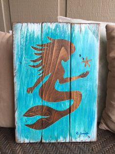 Stained or painted mermaid silhouette on painted or stained pallet wood boards. Great for babys nursery, girls room, a bathroom or beach house! These measure up to approx 13.5 x 10.5 I free hand design all of my silhouette items & use them as a stencil for custom orders. Custom order options: * solid color mermaid, or *wood stained mermaid (medium or dark shade) *background colors *slightly staggered boards or not staggered Or Any of the mermaids pictured in this listing can be duplicated…