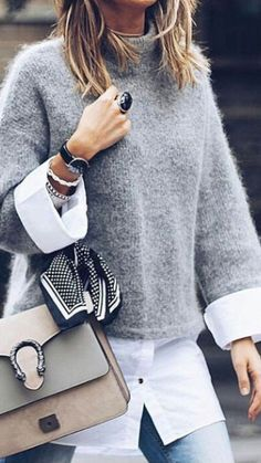 How to style a white button up by pairing it with a gray sweater, handbag, and light denim