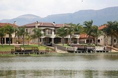 This magnificent upmarket home on the banks of the Hartbeespoort Dam is simply stunning. It has everything you could ask for in a family home and lots more. Banks, Home And Family, African, Mansions, House Styles, Life, Beautiful, Vacation, Mansion Houses