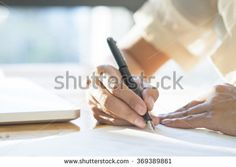 Asian Business woman signing a contract document making a deal, selective focus.